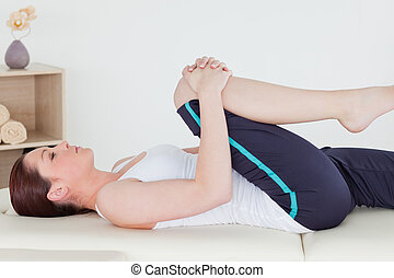 Sportswoman stretching her leg