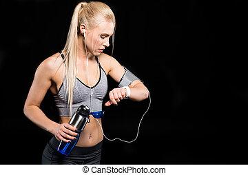 Sportswoman using smartwatch