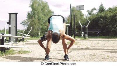 Sportswoman warming up in park