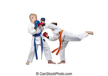 Sportswoman with red overlays on hands beats gyaku-tsuki boy