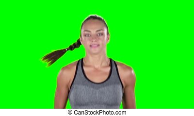 Sportwoman. Running girl. Front. Green screen. Slow motion