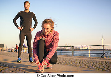 Sporty active couple on a seafront promenade