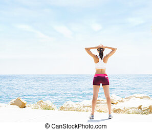 Sporty and beautiful girl doing sports outdoor. Gym, fitness, healthy lifestyle.