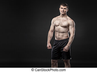 Sporty and healthy man isolated on black background