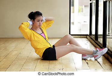 Sporty asian woman doing sit ups training