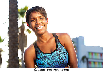 Sporty attractive african american woman laughing