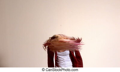 Sporty blonde shaking her hair in slow motion