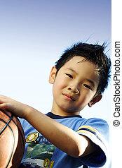 Sporty boy - A boy playing basketball outside