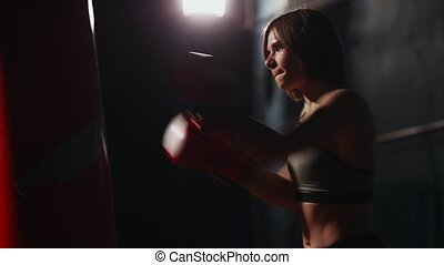 Sporty brunette Boxing gym provides individual training on...