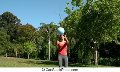 Sporty brunette playing football - Sporty brunette playing...