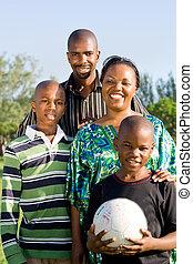 sporty family - happy family with football