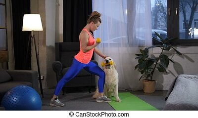 Sporty fit woman with dog assistant training arms - Slim...