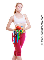 Sporty fit woman with measure tapes fruit. Time for diet slimming.