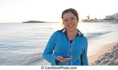 Sporty fitness woman on beach