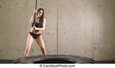 Sporty Girl Doing Sledgehammer Workout. - Sporty Girl Doing...