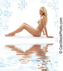 sporty girl in bikini on white sand