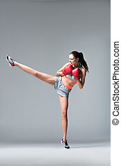 sporty girl in boxing gloves