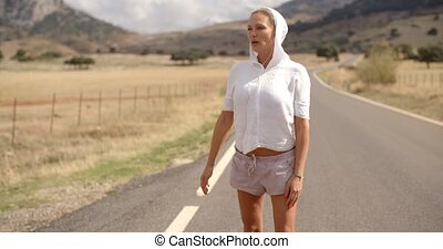 Sporty Girl in Hooded Sweatshirt Standing Alone in Spanish...