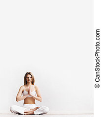 Sporty girl meditating. Yoga exercise.