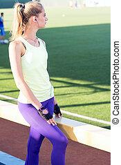 Sporty girl on the stadium