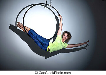 Sporty girl posing with aerial hoop - Woman doing ...