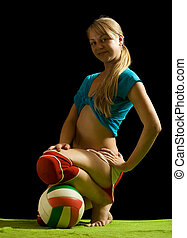 sporty girl posing with ball