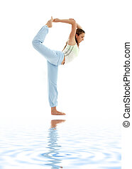 natarajasana lord of the dance pose on white sand - sporty...