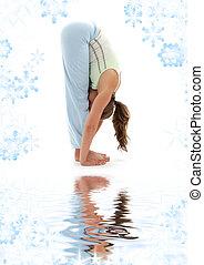 uttanasana standing forward bend on white sand - sporty girl...