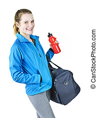 Sporty girl ready for workout - Smiling fit young woman with...