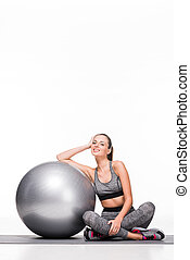 sporty girl with fitness ball