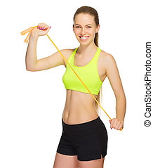 Sporty girl with skipping rope
