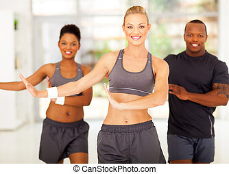 sporty group exercising  - cute sporty group exercising