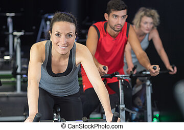 sporty group of people on spinning class