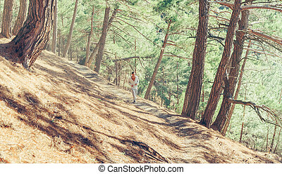 Sporty guy running on rugged terrain - Sporty young man ...