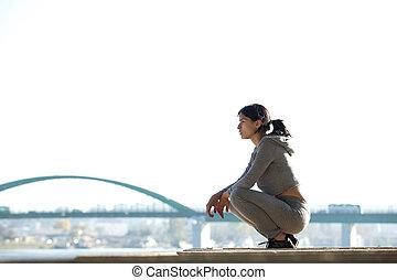 sporty, młoda kobieta, posiedzenie, outdoors