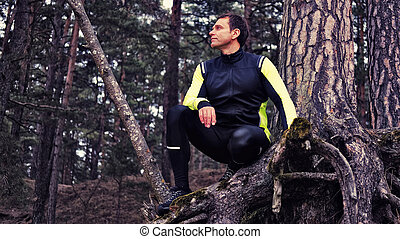 Sporty man in a forest.