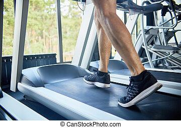 Sporty Man Running on Treadmill