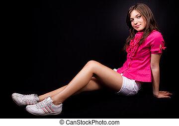 sporty, mulher jovem, com, excitado, pernas longas