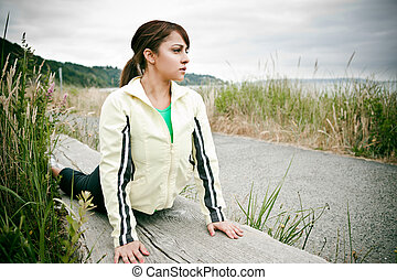 Sporty woman - A beautiful asian woman exercises in a park