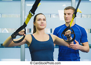 sporty woman and man doing gymnastic exercises or exercising in fitness class