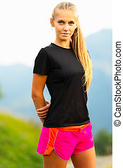 Sporty woman athlete posing in the nature