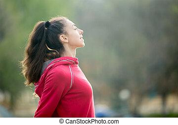 Sporty woman breathing fresh air
