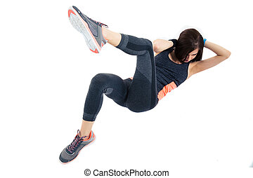 Sporty woman doing abdominal exercises