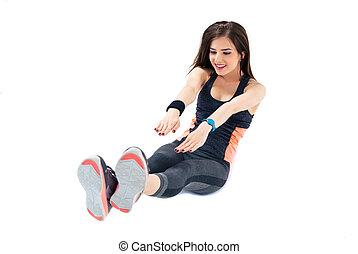 Sporty woman doing abdominal exercises