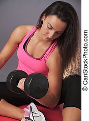 Sporty Woman Doing Biceps Exercise