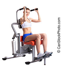 Sporty woman doing exercises on trainer