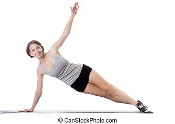 Sporty woman doing side plank exercise