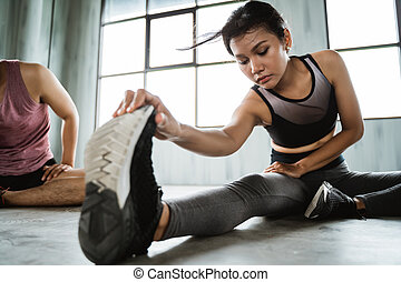 sporty woman doing stretching legs