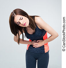 Sporty woman having pain in stomach