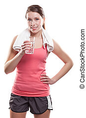 Sporty woman holding water - An isolated shot of a beautiful...